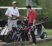 Honolulu, HI - December 21, 2008 -- United States President-elect Barack Obama chats with Obama staff member Eugene Kang before a round of golf, near Kailua, Hawaii, USA, on Sunday, 21 December 2008. Obama and family are staying in Hawaii through the winter holidays before he takes office 20 January 2009..Credit: Kent Nishimura - Pool via CNP