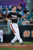 Aberdeen IronBirds shortstop Adam Hall (1) loses his helmet as he tries to lay down a bunt during a game against the Staten Island Yankees on August 23, 2018 at Leidos Field at Ripken Stadium in Aberdeen, Maryland.  Aberdeen defeated Staten Island 6-2.  (Mike Janes/Four Seam Images)