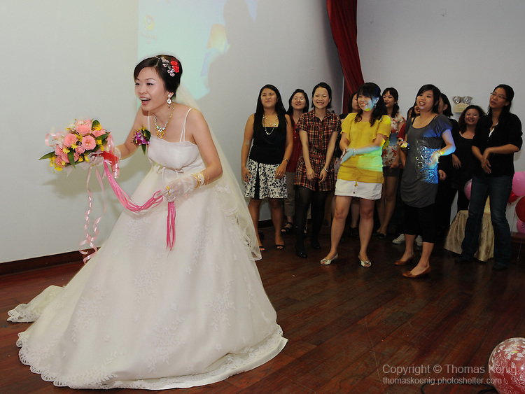 Taiwanese Wedding -- The bride tosses a bouquet of flowers to unmarried girls at the wedding.<br /> <br /> Now a very popular activity at Taiwanese weddings, this custom was undoubtedly imported from the West.
