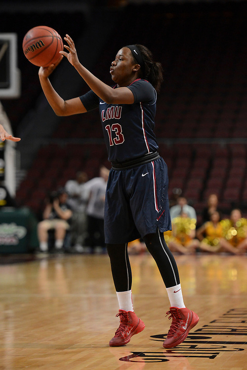 March 6, 2014; Las Vegas, NV, USA; Loyola Marymount Lions guard Deanna Johnson (13) shoots against the San Francisco Lady Dons during the second half of the WCC Basketball Championships at Orleans Arena.
