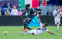 CARSON, CA - SEPTEMBER 29: Jonathan dos Santos #8 of the Los Angeles Galaxy attempts to slide tackle Tosaint Ricketts #87 of the Montreal Impact during a game between Vancouver Whitecaps and Los Angeles Galaxy at Dignity Health Sports Park on September 29, 2019 in Carson, California.