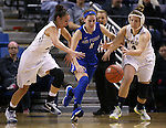 Nevada's MorningRose Tobey, left, and Halie Bergman, right, and Air Force's Cortney Porter battle for a loose ball in a women's basketball game in Reno, Nev., on Saturday, Jan. 9, 2016. Nevada won 68-57.<br /> Photo by Cathleen Allison