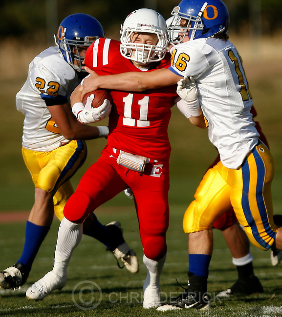 Chris Detrick  |  The Salt Lake Tribune.East's Mickey Taylor (11) is tackled by Orem's Luke Steele (22) and Orem's Danny Balser (16) during the game at East High School Friday October 28, 2011.  East won the game 31-13.