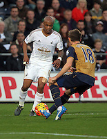(L-R) Andre Ayew of Swansea against Nacho Monreal of Arsenal during the Barclays Premier League match between Swansea City and Arsenal at the Liberty Stadium, Swansea on October 31st 2015