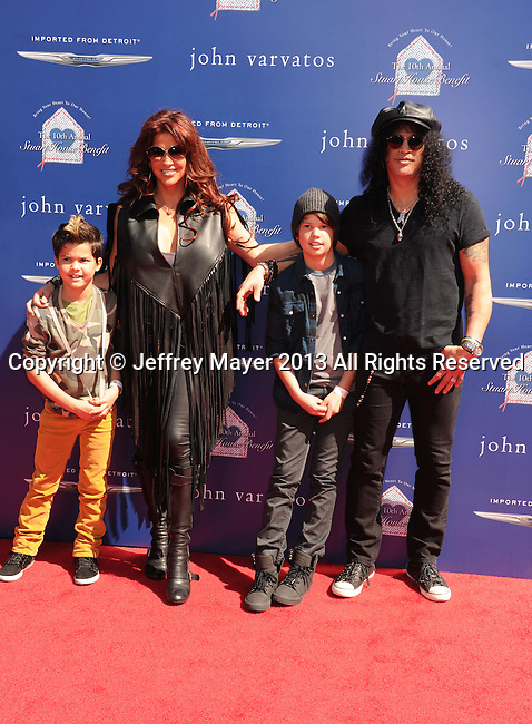 LOS ANGELES, CA - MARCH 10: Slash and family arrive at John Varvatos 10th Annual Stuart House Benefit at John Varvatos Los Angeles on March 10, 2013 in Los Angeles, California.