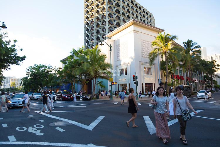 Kalakaua Avenue, the main street that runs parallel to Waikiki beach, is famous for its shopping and nightlife in Honolulu, Oahu, Hawaii