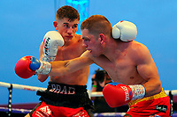 Brad Foster (black/red shorts) defeats Ashley Lane during a Boxing Show at Stevenage Football Club on 18th May 2019