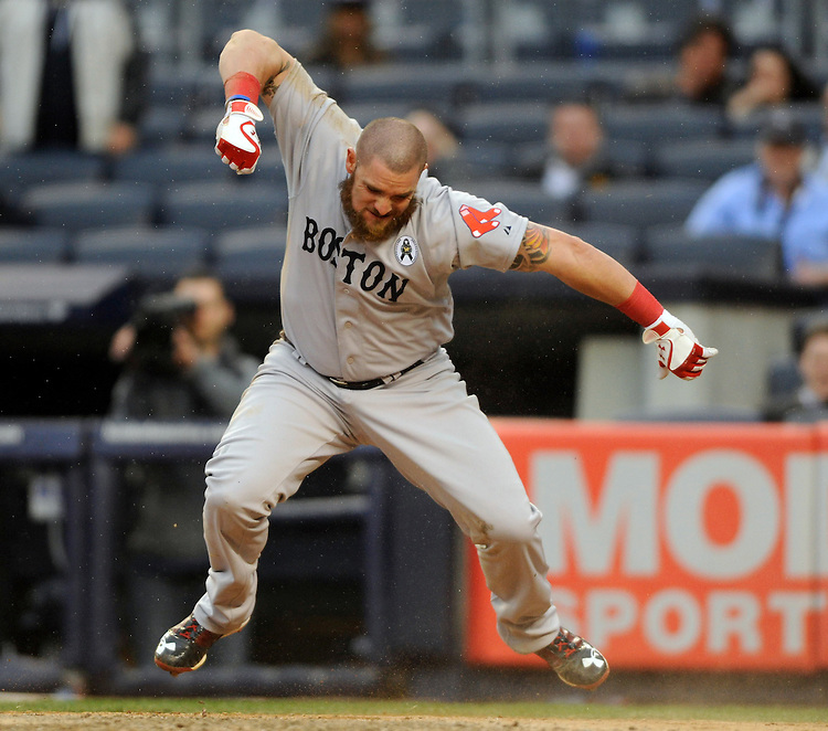 Boston Red Sox designated hitter Jonny Gomes celebrates after scoring during the ninth inning at Yankee Stadium on Monday, April 01, 2013. Photo by Christopher Evans