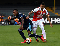 BOGOTA - COLOMBIA - 01 - 03 - 2018: Yeison Gordillo (Der.) jugador de Independiente Santa Fe disputa el balón con Eduar Preciado (Izq.) jugador de Emelec (ECU), durante partido entre Independiente Santa Fe (COL) y Emelec (ECU), de la fase de grupos, grupo 4, fecha 1 de la Copa Conmebol Libertadores 2018, jugado en el estadio Nemesio Camacho El Campin de la ciudad de Bogota. / Yeison Gordillo (R) player of Independiente Santa Fe vies for the ball with Eduar Preciado (L) player of of Emelec (ECU), during a match between Independiente Santa Fe (COL) and Emelec (ECU), of the group stage, group 4, 1st date for the Conmebol Copa Libertadores 2018 at the Nemesio Camacho El Campin Stadium in Bogota city. Photo: VizzorImage  / Luis Ramirez / Staff.