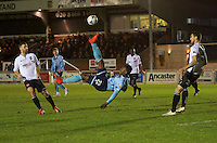 Aristote Nsiala of Grimsby Town tries an overhead kick during the Vanarama National League match between Bromley and Grimsby Town at Hayes Lane, Bromley, England on 9 February 2016. Photo by Alan  Stanford.