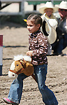 Fallon's Sequoya Casey's hat blows off as she competes in the Pee-Wee Stick Horse Barrel race at the Fallon Junior Rodeo.  Photo by Tom Smedes.