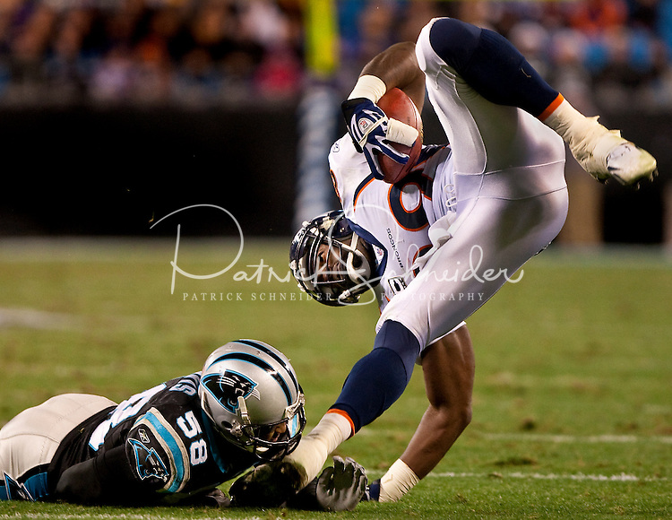 Denver Broncos wide receiver Eddie Royal (19) is tackled by Carolina Panthers linebacker Thomas Davis (58)  during an NFL football game at Bank of America Stadium in Charlotte, NC.