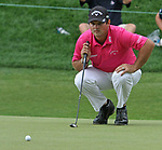 Cromwell, CT-23 JUNE 23 2017-062317MK01 Patrick Reed lines his birdie putt at the 18th green Friday afternoon at the 2017 Travelers Championship at the TPC River Highlands in Cromwell.  Reed sunk the putt to take a share of 2nd place with a round of 66 .  Michael Kabelka / Republican-American
