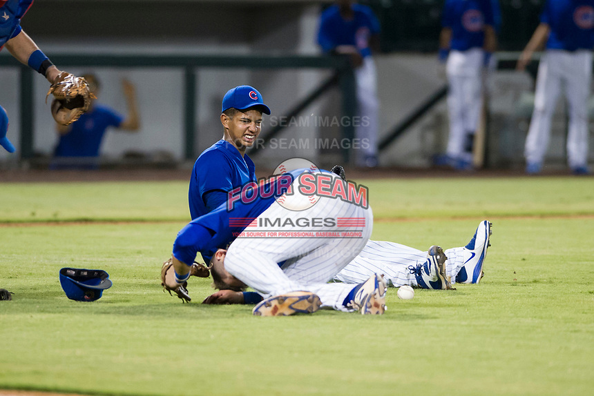 AZL Cubs relief pitcher Eury Ramos (81) reacts after a collision with third baseman Cam Balego (82) and first baseman Luis Hidalgo (18) during a game against the AZL Giants on September 6, 2017 at Sloan Park in Mesa, Arizona. AZL Giants defeated the AZL Cubs 6-5 to even up the Arizona League Championship Series at one game a piece. (Zachary Lucy/Four Seam Images)