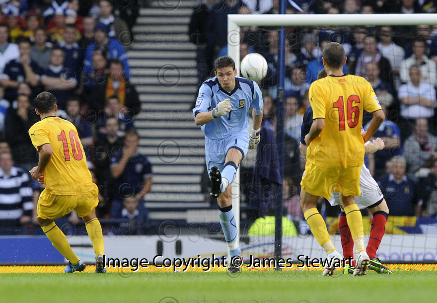 05/09/2009  Copyright  Pic : James Stewart.sct_jspa04_scotland_v_macedonia  .CRAIG GORDON RUSHES FROM HIS LINE TO CLEAR ....James Stewart Photography 19 Carronlea Drive, Falkirk. FK2 8DN      Vat Reg No. 607 6932 25.Telephone      : +44 (0)1324 570291 .Mobile              : +44 (0)7721 416997.E-mail  :  jim@jspa.co.uk.If you require further information then contact Jim Stewart on any of the numbers above.........