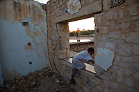 A child plays in the ruined State House building, Hargeysa Somaliland. The grand palace, built in 1952, is now the home to thousands of IDP's. Recently refugees have come from Mogadishu to find  a safe haven here.