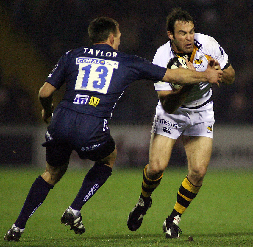 Photo: Paul Thomas..Sale Sharks v London Wasps. Guinness Premiership. 03/11/2006...Fraser Waters (R) of Wasps is tackled by Mark Taylor.