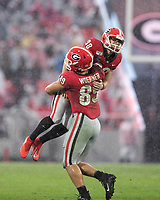 ATHENS, GA - NOVEMBER 23: Rodrigo Blankenship #98 and Charlie Woerner #89 of the Georgia Bulldogs celebrates after a field goal during a game between Texas A