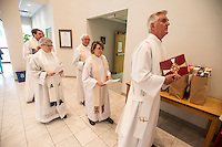 NWA Democrat-Gazette/ANTHONY REYES &bull; @NWATONYR<br /> Deacon John Reese, with All Saints Episcopal Church, prepares to lead the celebrants of the Ascension Day service Thursday, May 14, 2015 into the church at St. Thomas Episcopal in Springdale. St. Thomas held a joint worship service with other area churches in Fayetteville.