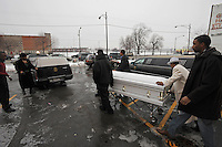 Friends and family help take the casket of housing activist Beauty Turner, 51, a one-time resident of the Robert Taylor Homes who led the Beauty Turner Ghetto Bus Tour and received national recognition in publications such as The Wall Street Journal, into the hearse in the parking lot of the Greater Harvest Missionary Baptist Church on South State Street in Chicago, Illinois on December 26, 2008.  Turner died of an aneurysm on December 18.