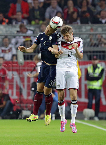 07.09.2014. Dortmund, Germany.   international match Germany Scotland  in Signal Iduna Park in Dortmund. Heading duel between Steven Whittaker Scotland and Thomas Mueller Germany