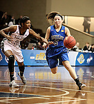 SIOUX FALLS MARCH 22:  Jane White #5 from Bentley University drives against Taylor White #25 from Virginia Union during their quarterfinal game at the NCAA Women's Division II Elite 8 Tournament at the Sanford Pentagon in Sioux Falls, S.D.  (Photo by Dave Eggen/Inertia)
