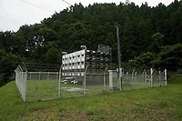 A water storage tank during reconstruction efforts following the 311 Tohoku Tsunami in Ofunato, Japan  © LAN