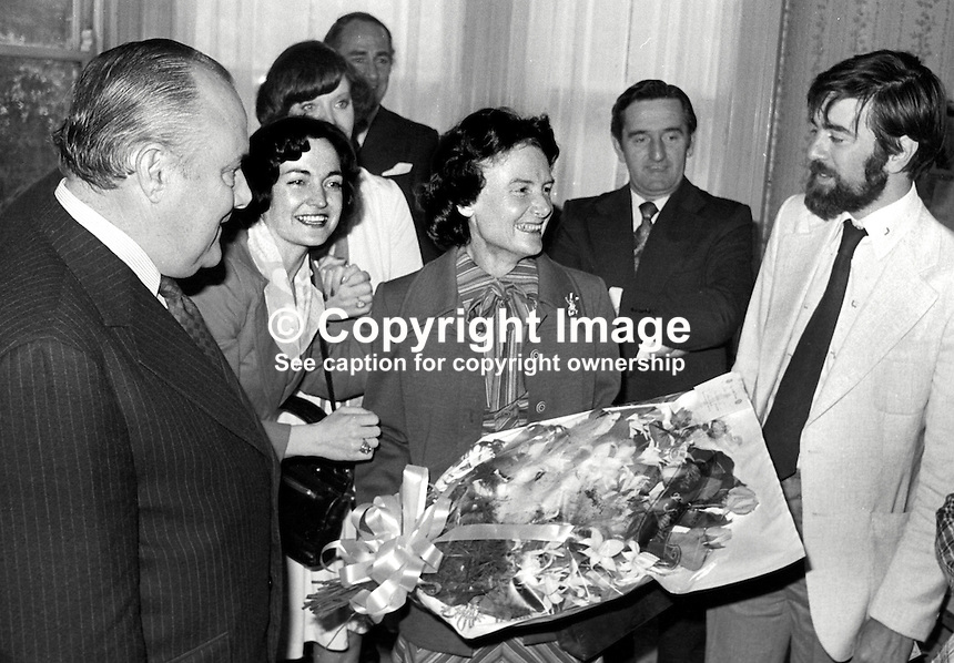 New Zealand Prime Minister Robert Muldoon, accompanied by his wife Thea Muldoon, centre with bouquet, visited the Peace People in Belfast during a two day visit to N Ireland.  Also in the photo are Mairead Corrigan and behind her Betty Williams, partially hidden, founders of the Peace People, as is Ciaran McKeown (with beard), former Belfast journalist who was an early activist. 197706190207b.<br />