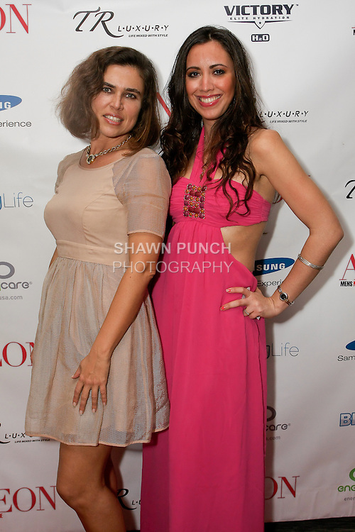 (l-r) Guest and TR Luxury hostess attends the Aeon Magazine Launch Party, at the Samsung Experience in the Time Warner Center,  November 15, 2011.