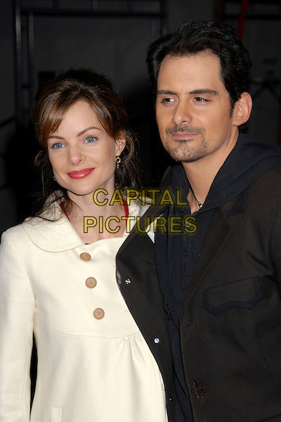 """KIMBERLY WILLIAMS PAISLEY & BRAD PAISLEY .""""Walk Hard: The Dewey Cox Story"""" Los Angeles Premiere at Grauman's Chinese Theatre, Hollywood, California, USA..December 12th, 2007.half length black jacket goatee facial hair cream white coat married husband wife .CAP/ADM/BP.©Byron Purvis/AdMedia/Capital Pictures."""