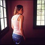Woman inside by windowlight