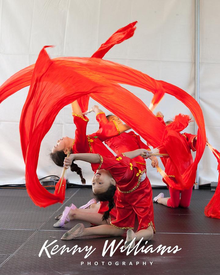 Girls performing Chinese Red Fan Fire Dance, Northwest Folklife Festival 2016, Seattle Center, Washington, USA.