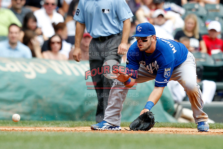 Kansas City Royals third baseman Mike Moustakas #8 fields a ground ball during a game against the Chicago White Sox at U.S. Cellular Field on August 14, 2011 in Chicago, Illinois.  Chicago defeated Kansas City 6-2.  (Mike Janes/Four Seam Images)