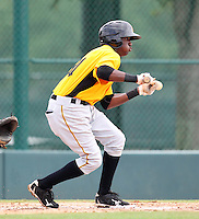 GCL Pirates shortstop Alen Hanson #31 looks to bunt during a game against the GCL Braves at Disney Wide World of Sports on June 25, 2011 in Kissimmee, Florida.  The Pirates defeated the Braves 5-4 in ten innings.  (Mike Janes/Four Seam Images)