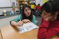 NWA Democrat-Gazette/J.T. WAMPLER Sabrina Arellano works with Yarethzy Laguna Tuesday May 7, 2019 at Lee Elementary School in Springdale. Arellano, a second-grade teacher, in 2011 became the first Hispanic teacher in the Springdale school system who had gone through the Springdale schools herself.