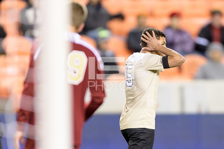 Houston, TX - Friday December 9, 2016: Steven Echevarria  (15) of the Wake Forest Demon Deacons reacts to missing his shot on goal against the Denver Pioneers at the NCAA Men's Soccer Semifinals at BBVA Compass Stadium in Houston Texas.