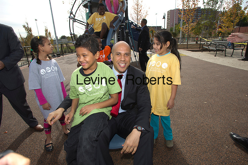 Newark Mayor Corey A. Booker with kids   at Kompan playground.  Jesse Allen Park Phase II Opening Celebration, Newark, NJ on Wednesday, October 17, 2012. KIDS IN TPL T SHIRTS ARE MODEL RELEASED.  (© Frances M. Roberts)