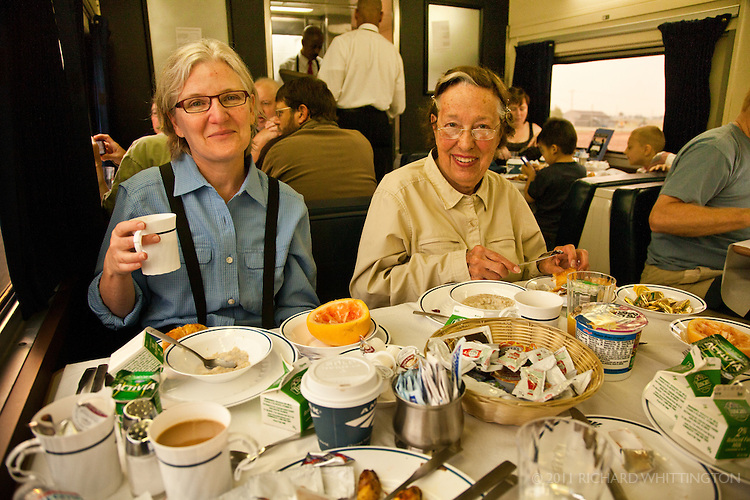 Michelle and Jackie Williamson eating breakfast on the Empire Builder, the Amtrak train from Chicago to Seattle.