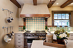 The Hathcoat's kitchen features ceiling beams, new backsplash, new appliances, new cabinets, a farmer sink on a new kitchen island under new lighting, after being transformed by the crew on DIY Network's original series, Kitchen Crashers.