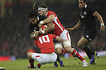 Cardiff, WALES - November 24:.Autumn International.Wales v New Zealand.Sam Warburton and Rhys Priestland combine to stop All Blacks centre Ma'a Nonu..24.11.12..©Steve Pope - Sportingwales