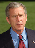 "Washington, DC - September 16, 2001 -- United States President George W. Bush returns from a week-end at Camp David on Sunday, September 16, 2001.  In remarks to the press as walked to the White House,  President Bush warned ""We need to be alert to the fact that these evil-doers still exist""  and urged Americans to not let terrorism distract them from their normal routines..Credit: Ron Sachs / CNP"