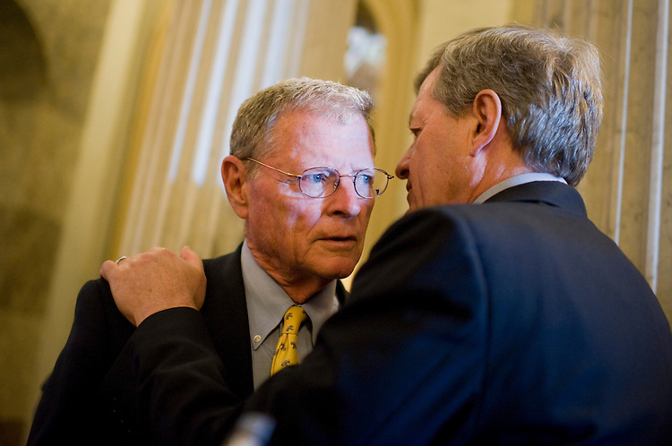 UNITED STATES - AUGUST 02:  Sen. Jim Inhofe, R-Okla., left, and Max Baucus, D-Mont., confer off the floor before the Senate passed a deal to raise the nation's debt limit and reduce the deficit.  (Photo By Tom Williams/Roll Call)