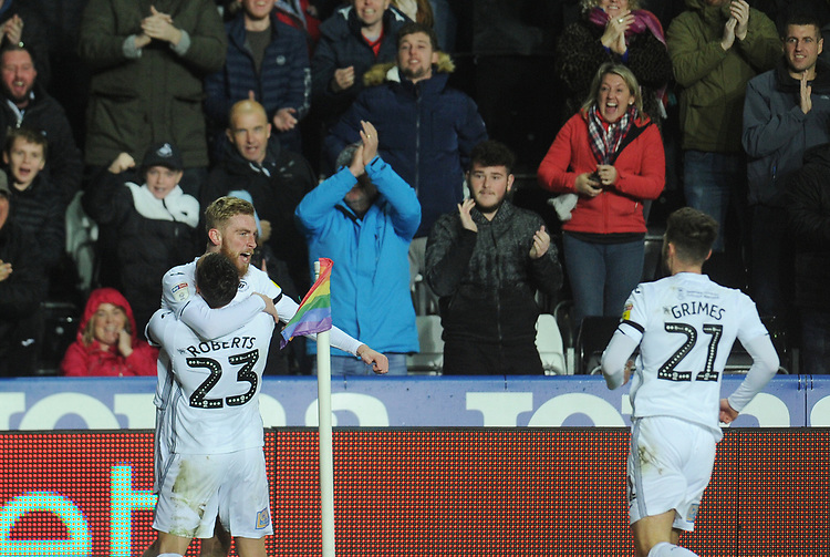Swansea City's Oli McBurnie celebrates scoring his side's first goal with team-mate Connor Roberts<br /> <br /> Photographer Kevin Barnes/CameraSport<br /> <br /> The EFL Sky Bet Championship - Swansea City v West Bromwich Albion - Wednesday 28th November 2018 - Liberty Stadium - Swansea<br /> <br /> World Copyright © 2018 CameraSport. All rights reserved. 43 Linden Ave. Countesthorpe. Leicester. England. LE8 5PG - Tel: +44 (0) 116 277 4147 - admin@camerasport.com - www.camerasport.com