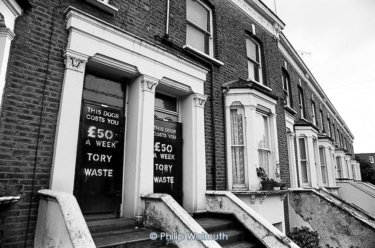 Empty and boarded-up houses on Walterton Estate, in North Paddington, London, before residents forced  Westminster Council to abandon a plan to sell the estate to private developers. (June 1989)