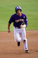 LSU Tigers first baseman Tyler Moore #2 runs to third base during the NCAA Super Regional baseball game against Stony Brook on June 9, 2012 at Alex Box Stadium in Baton Rouge, Louisiana. Stony Brook defeated LSU 3-1. (Andrew Woolley/Four Seam Images)