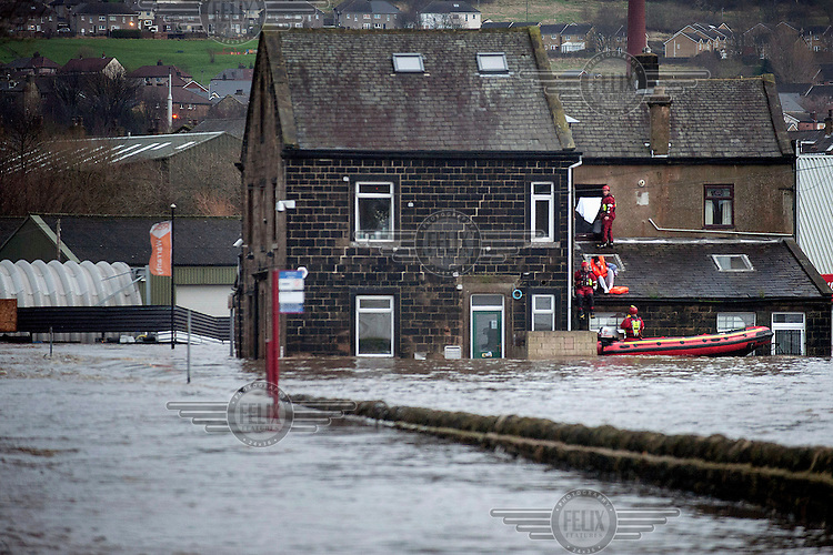 Residents of Baildon Bridge being rescued from their homes by the Fire and Rescue Service when the River Aire was one of many Yorkshire rivers that broke its banks on Boxing Day.