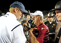 Sept. 19, 2009; Provo, UT, USA; Florida State Seminoles head coach Bobby Bowden (right) speaks with BYU Cougars head coach Bronco Mendenhall following the game at LaVell Edwards Stadium. Florida State defeated BYU 54-28. Mandatory Credit: Mark J. Rebilas-