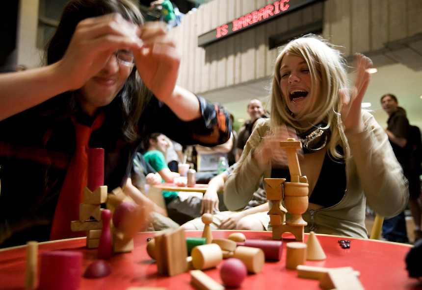 Photo by Stephen Brashear.Ashley Alto, right, of Calgary, Alb., reacts as the Dan Gallardo's stack tumbles to the table during a game of Bausack, a German game in which players win by building the longest standing stack, during the second day of the Penny Arcade Exposition at the Washington State Visitor and Convention Center in Seattle, Wash., Saturday Aug. 29, 2008.