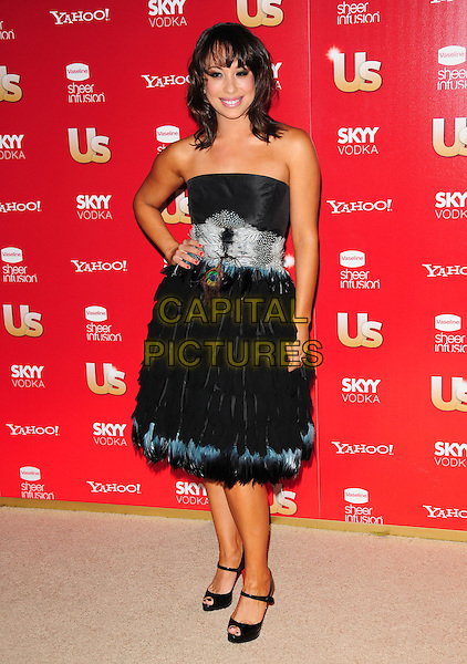 CHERYL BURKE.US Weekly's Hot Hollywood Party 2009 held at Voyeur, West Hollywood, California, USA. .November 18th, 2009.full length black strapless dress blue grey gray feathers hand on hip.CAP/RKE/DVS.©DVS/RockinExposures/Capital Pictures.