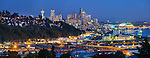 Seattle, Washington<br /> Panoramic night view of the city skyline, Elliott Bay and hillside homes of the Queen Ann neighborhood
